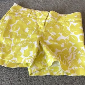 The limited green & white floral shorts size 8